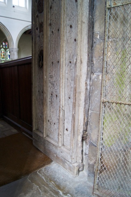 St George's Gt Bromley Essex 2015 repairs South door open, damaged hinge and rusty bird cage door